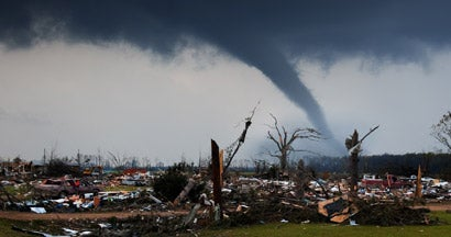 A tornado on the ground shortly after destroying a small neighborhood.