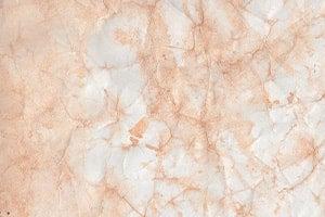 Hellrosa marmorierter Hintergrund