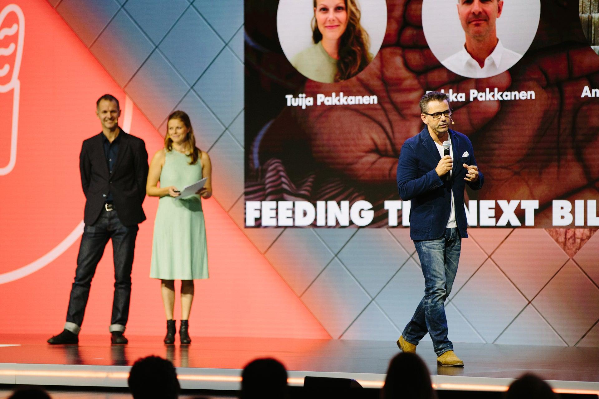 Three people on stage
