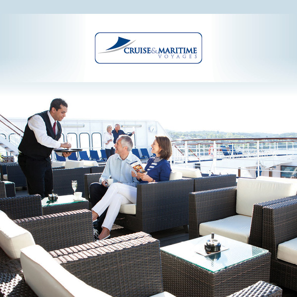 A couple are served drinks by a waiter, on board a cruise ship.